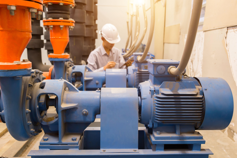 Engineer inspecting pump to avoid Cavitation